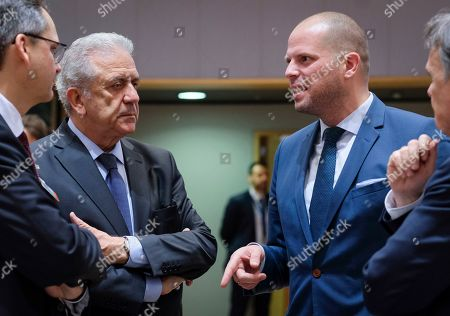EU Commissioner for migration and home affairs Dimitris Avramopoulos (L) chats with  Belgian Secretary of State for Asylum, Migration, member of NVA Party  Theo Francken during an European Interior Minister council in Brussels, Belgium 06 December 2018. Ministers are expected to discuss a proposed regulation on the European Border and Coast Guard. In Belgium NVA t(New Flemish Alliance) the leading Flemish nationalist  political party is in opposition with European Immigration policy.  To Belgian Prime Minister Charles Michel will ask the Parliament to vote on the signing agreement on international migration to prevent the government from collapsing. Michel opposed his coalition partner, the New Flemish Alliance (N-VA), to find out if Belgium should sign the UN Global Compact on Migration.