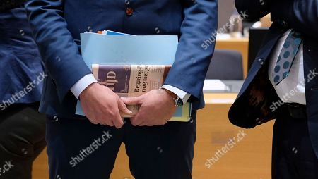 """Belgian Secretary of State for Asylum, Migration, member of NVA Party  Theo Francken hold news paper with Title """"Government still not sav.."""" during an European Interior Minister council in Brussels, Belgium 06 December 2018. Ministers are expected to discuss a proposed regulation on the European Border and Coast Guard. In Belgium NVA t(New Flemish Alliance) the leading Flemish nationalist  political party is in opposition with European Immigration policy.  To Belgian Prime Minister Charles Michel will ask the Parliament to vote on the signing agreement on international migration to prevent the government from collapsing. Michel opposed his coalition partner, the New Flemish Alliance (N-VA), to find out if Belgium should sign the UN Global Compact on Migration."""