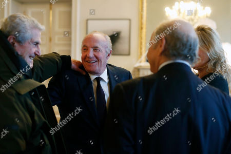 U.S actor James Caan, center left, talks with French director Claude Lelouch prior to be awarded with the Vermeil Paris medal, at the Paris city Hall, in Paris