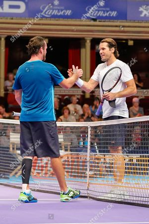Stock Image of Xavier Malisse and Tommy Haas shake hands after the Champions Tennis match at the Royal Albert Hall, London. Picture by Ian Stephen