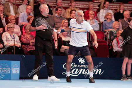 Stock Photo of Mansour Bahrami joking with the line umpire during the Champions Tennis match at the Royal Albert Hall, London. Picture by Ian Stephen