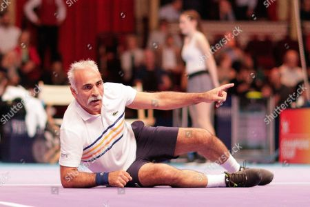 Stock Picture of Mansour Bahrami joking on the ground during the Champions Tennis match at the Royal Albert Hall, London. Picture by Ian Stephen