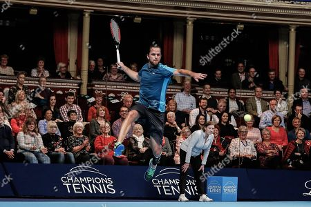Xavier Malisse jumps to hit a return ball during the Champions Tennis match at the Royal Albert Hall, London. Picture by Ian Stephen