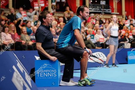 A line umpire doesn't look too impressed that Xavier Malisse decided to use him for a chair during the Champions Tennis match at the Royal Albert Hall, London. Picture by Ian Stephen