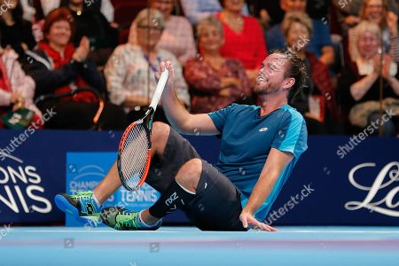 Xavier Malisse laughing on the ground during the Champions Tennis match at the Royal Albert Hall, London. Picture by Ian Stephen