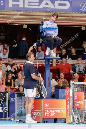 Henri Leconte joking with the chair umpire during the Champions Tennis match at the Royal Albert Hall, London. Picture by Ian Stephen