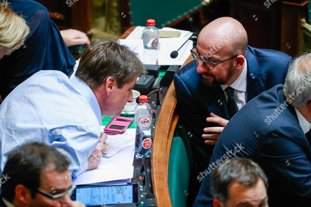 Belgian Prime Minister Charles Michel (R) and Mouvement Reformateur (MR) party chairman Olivier Chastel chat at the start of a plenary session in Brussels, Belgium, 06 December 2018. Reports state that the Belgian Parliament has to vote on the UN migration pact during the session on 06 December 2018.