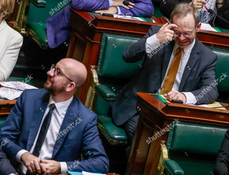 Belgian Prime Minister Charles Michel (L) and N-VA's head of group Peter De Roover react at the start of a plenary session in Brussels, Belgium, 06 December 2018. The Balgian Parliament has to vote for the UN migration pact on the same day.