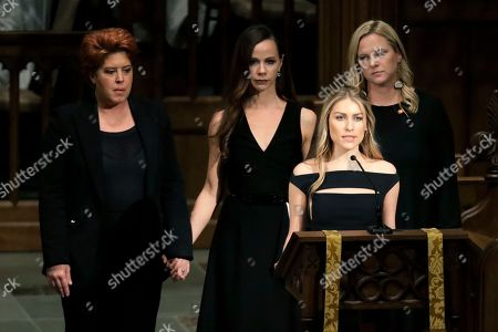 Elizabeth Dwen Andrews reads scripture during a funeral service for former President George H.W. Bush at St. Martin's Episcopal Church, in Houston. At back are Noelle Lucila Bush, Barbara Pierce Bush and Marshall Lloyd Bush