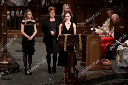 Stock Picture of Granddaughter Barbara Pierce Bush reads scripture during a funeral for former President George H.W. Bush at St. Martin's Episcopal Church, in Houston. At back are Elizabeth Dawn Andrews, Noelle Lucila Bush and Marshall Lloyd Bush