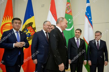 (L-R) Kyrgyzstan's President Sooronbay Jeenbekov, Moldovan President Igor Dodon, Russian President Vladimir Putin, Turkmenistan's President Gurbanguly Berdymukhamedov and Uzbek President Shavkat Mirziyoyev leave after posing for a family photo  before a meeting of heads of the Commonwealth of Independent States (CIS) in Saint Petersburg, Russia, 06 December 2018.