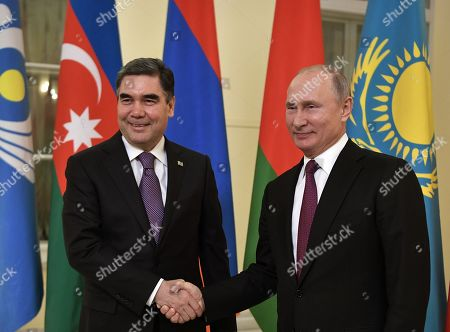 Russian President Vladimir Putin (R) shakes hands with Turkmenistan's President Gurbanguly Berdymukhamedov (L) as they pose for a picture during the Commonwealth of Independent States (CIS) summit in St.Petersburg, Russia, 06 December 2018.