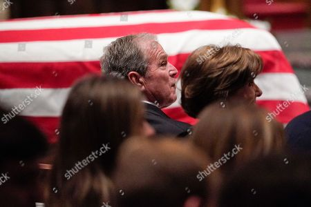 Former US President George W. Bush and former First Lady Laura Bush listen during a funeral service for former US President George H.W. Bush at St. Martin?s Episcopal Church in Houston, Texas, USA, 06 December 2018. Bush died at the age of 94 on 30 November 2018 at his home in Texas. George H.W. Bush was the 41st President of the United States (1989-1993).