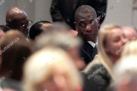 Stock Image of Former NBA basketball player Dikembe Mutombo (C) attends a funeral service for former US President George H.W. Bush at St. Martin's Episcopal Church in Houston, Texas, USA, 06 December 2018. Bush died at the age of 94 on 30 November 2018 at his home in Texas. George H.W. Bush was the 41st President of the United States (1989-1993).