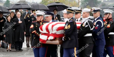 Former US President George W. Bush and former First Lady Laura Bush watch as the flag-draped casket of former US President George H.W. Bush is carried by a joint services military honor guard to a Union Pacific train in Spring, Texas, USA, 06 December 2018. Bush died at the age of 94 on 30 November 2018 at his home in Texas. George H.W. Bush was the 41st President of the United States (1989-1993).