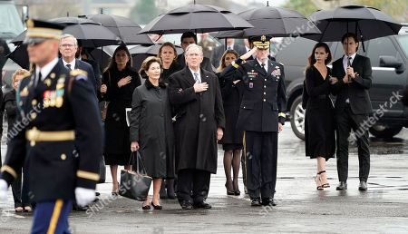Former US President George W. Bush and former First Lady Laura Bush and other family members watch as the flag-draped casket of former US President George H.W. Bush is carried by a joint services military honor guard to a Union Pacific train in Spring, Texas, USA, 06 December 2018. Bush died at the age of 94 on 30 November 2018 at his home in Texas. George H.W. Bush was the 41st President of the United States (1989-1993).