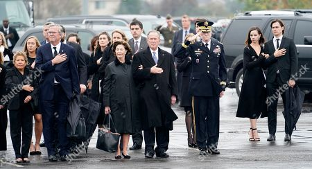 Former President George W. Bush and Laura Bush watch as the flag-draped casket of former US President George H.W. Bush is carried by a joint services military honor guard  to a Union Pacific train in Spring, Texas, USA, 06 December 2018. At left is Columba Bush and her husband Jeb Bush and at far right is Barbara Bush and her husband Craig Coyne. Army Maj. Gen. Michael L. Howard, commanding general, Joint Task Force-National Capital Region salutes. Bush died at the age of 94 on 30 November 2018 at his home in Texas. George H.W. Bush was the 41st President of the United States (1989-1993).