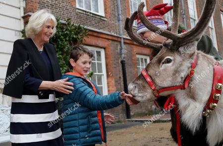 Children attend a Christmas event at Clarence House, London