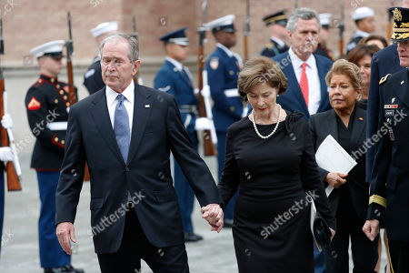 George H.W. Bush, George W. Bush, Laura Bush. Former President George W. Bush and his wife, Laura Bush leave St. Martin's Episcopal Church in Houston after the funeral service for his father, former President George H.W. Bush on