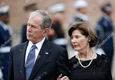 George H.W. Bush, George W. Bush, Laura Bush. Former President George W. Bush and his wife, Laura Bush, leave St. Martin's Episcopal Church in Houston after the funeral service for his father, former President George H.W. Bush on