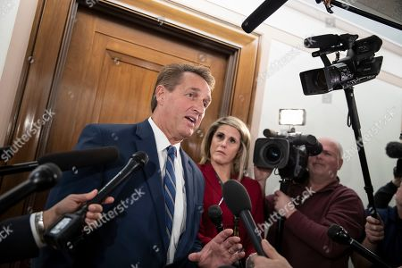 Stock Photo of Sen. Jeff Flake, R-Ariz., a member of the Senate Foreign Relations Committee, speaks with reporters as senators are considering multiple pieces of legislation in an effort to formally rebuke Saudi Arabia for the slaying of journalist Jamal Khashoggi, on Capitol Hill in Washington