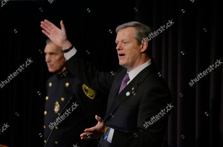 Stock Image of Massachusetts Gov. Charlie Baker, right, addresses an audience as Arlington, Mass., Police Chief Frederick Ryan, left, looks, during a national summit focused on police efforts to address the opioid epidemic at Harvard Medical School, in Boston