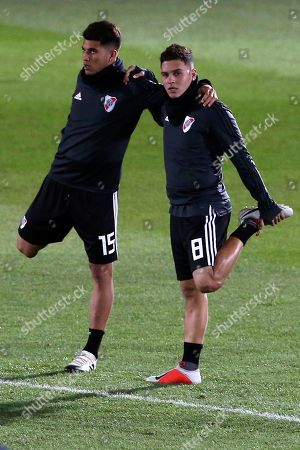 River Plate players Juan Fernando Quintero, right, and Exequiel Palacios warm up during a training session in Madrid, Spain, . The Copa Libertadores Final will be played on Dec. 9 in Spain at Real Madrid's stadium for security reasons after River Plate fans last Saturday attacked the Boca Junior team bus heading into the Buenos Aires stadium for the meeting of Argentina's fiercest soccer rivals