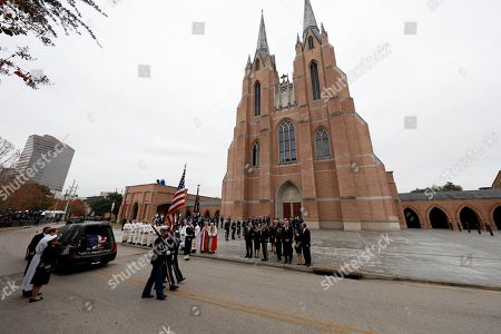 A military honor guard leaves after carrying the flag-draped casket of former US President George H.W. Bush to a hearse following his funeral service as his family including former President George W. Bush and his wife, Laura Bush, look on at St. Martin's church in Houston, Texas, USA, 06 December 2018. Bush died at the age of 94 on 30 November 2018 at his home in Texas. George H.W. Bush was the 41st President of the United States (1989-1993).