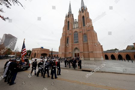 A military honor guard leaves after carrying the flag-draped casket of former President George H.W. Bush to a hearse following his funeral service as his family including former President George W. Bush and his wife, Laura Bush, look on at St. Martin's church in Houston, Texas, USA, 06 December 2018. Bush died at the age of 94 on 30 November 2018 at his home in Texas. George H.W. Bush was the 41st President of the United States (1989-1993).
