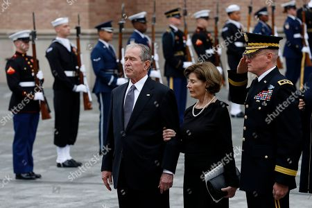 Former US President George W. Bush and his wife, Laura Bush, watch as former President George H.W. Bush's body is moved to a hearse following his funeral St. Martin's church in Houston, Texas, USA, 06 December 2018. Bush died at the age of 94 on 30 November 2018 at his home in Texas. George H.W. Bush was the 41st President of the United States (1989-1993).