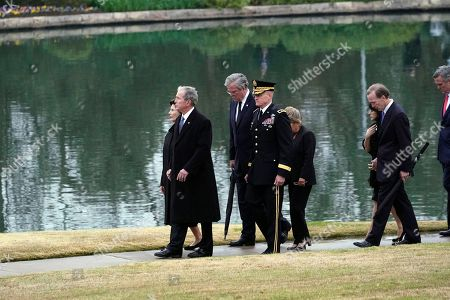 Former President George W. Bush and Laura Bush, along with Jeb and Columba Bush, Neil and Maria Bush and Marvin Bush, follow the flag-draped casket of former President George H.W. Bush for burial at the George H.W. Bush Presidential Library and Museum in College Station, Texas, USA, 06 December 2018. Bush died at the age of 94 on 30 November 2018 at his home in Texas. George H.W. Bush was the 41st President of the United States (1989-1993).