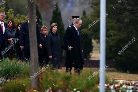 Former President George W. Bush and former first lady Laura Bush follow the flag-draped casket of former President George H.W. Bush at the George H.W. Bush Presidential Library and Museum  in College Station, Texas, USA, 06 December 2018. Bush died at the age of 94 on 30 November 2018 at his home in Texas. George H.W. Bush was the 41st President of the United States (1989-1993).