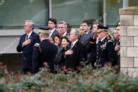 Jeb Bush, left, former President George W. Bush and Laura Bush and other family members watch as the flag-draped casket of former President George H.W. Bush is carried by a joint services military honor guard for burial at the George H.W. Bush Presidential Library and Museum in College Station, Texas, USA, 06 December 2018. Bush died at the age of 94 on 30 November 2018 at his home in Texas. George H.W. Bush was the 41st President of the United States (1989-1993).