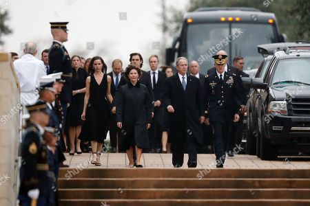Former US President George W. Bush walks with former first lady Laura Bush and their daughter Barbara Pierce Bush as the flag-draped casket of former President George H.W. Bush arrives the George H.W. Bush Presidential Library and Museum in College Station, Texas, USA, 06 December 2018. Bush died at the age of 94 on 30 November 2018 at his home in Texas. George H.W. Bush was the 41st President of the United States (1989-1993).