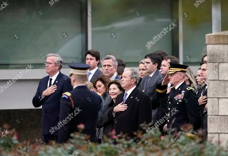 Jeb Bush (L), former President George W. Bush (C, right) and Laura Bush (C, left) and other family members watch as the flag-draped casket of former President George H.W. Bush is carried by a joint services military honor guard for burial at the George H.W. Bush Presidential Library and Museum  in College Station, Texas, USA, 06 December 2018. Bush died at the age of 94 on 30 November 2018 at his home in Texas. George H.W. Bush was the 41st President of the United States (1989-1993).
