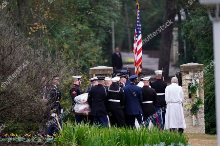 The flag-draped casket of former President George H.W. Bush is carried by a joint services military honor guard for burial at the George H.W. Bush Presidential Library and Museum, in College Station, Texas
