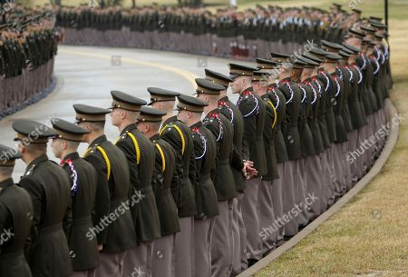 Members of the Texas A&M Corps of Cadets prepare to salute the motorcade of former President George H. W. Bush during his arrival and internment, at the George Bush Presidential Library & Museum in College Station, Texas