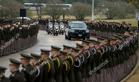 Members of the Texas A&M Corps of Cadets salute the motorcade of former President George H. W. Bush during his arrival and internment, at the George Bush Presidential Library & Museum in College Station, Texas