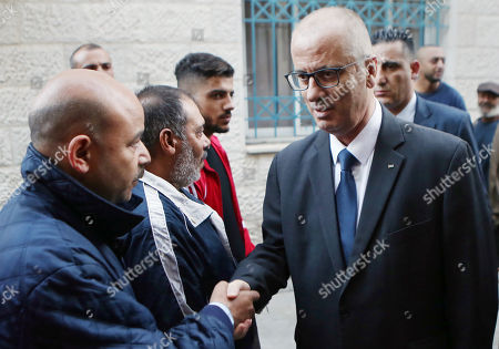 Palestinian Prime Minister Rami Hamdallah offers condolences for the family of Mohammad Habali, who was killed by Israeli forces, in the West Bank city of Tulkarem