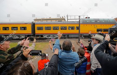 People pay their respects as the train carrying the casket of former President George H.W. Bush passes through Navasota, Texas