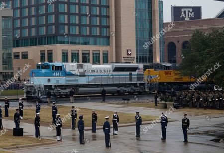Stock Image of The casket of President George H. W. Bush arrives by train to Texas A&M University for burial at the George Bush Presidential Library, in College Station