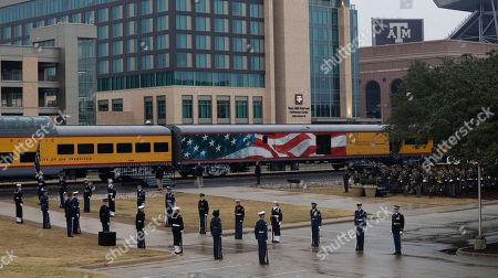 Stock Photo of The casket of President George H. W. Bush arrives by train to Texas A&M University for burial at the George Bush Presidential Library, in College Station