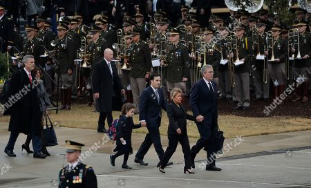 Jeb Bush, Columba Bush. Former Florida Gov. Jeb Bush, right, with wife Columba, walks past the Texas A&M band casket after they arrived by train with the casket of former President George H.W. Bush being transferred by train for burial at the George Bush Presidential Library, in College Station