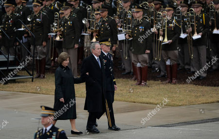 George W. Bush, Laura Bush. Former President George W. Bush, center, with wife Laura, left, walk past the Texas A&M band casket after they arrived by train with the casket of former President George H.W. Bush being transferred by train for burial at the George Bush Presidential Library, in College Station