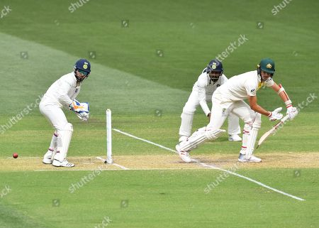 Patrick Cummins (R) of Australia bats during day two of the first Test match between Australia and India at the Adelaide Oval in Adelaide, Australia, 06 December 2018.