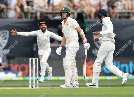 Patrick Cummins (C) of Australia is seen as Indian players celebrate his dismissal during day two of the first Test match between Australia and India at the Adelaide Oval in Adelaide, Australia, 06 December 2018.