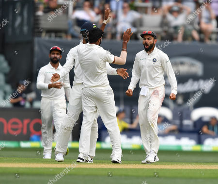 Virat Kohli of India (R) reacts after the dismissal of Patrick Cummins of Australia during day two of the first Test match between Australia and India at the Adelaide Oval in Adelaide, Australia, 06 December 2018.
