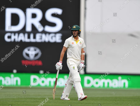 Patrick Cummins of Australia walks from the field after his dismissal during day two of the first Test match between Australia and India at the Adelaide Oval in Adelaide, Australia, 06 December 2018.