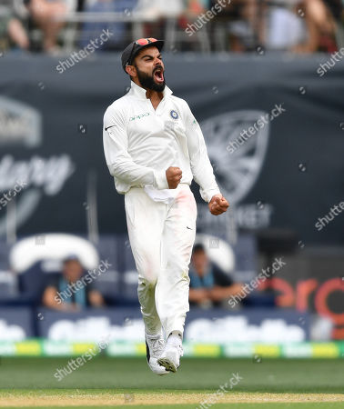 Virat Kohli of India reacts after the dismissal of Patrick Cummins of Australia during day two of the first Test match between Australia and India at the Adelaide Oval in Adelaide, Australia, 06 December 2018.