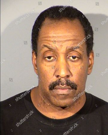 This undated Clark County Detention Center booking photo shows Robert John Griffin, 56, of Las Vegas. Clark County School District police say Griffin, a veteran school police sergeant, was arrested, on burglary charges after an investigation of items reported missing from a Las Vegas magnet high school